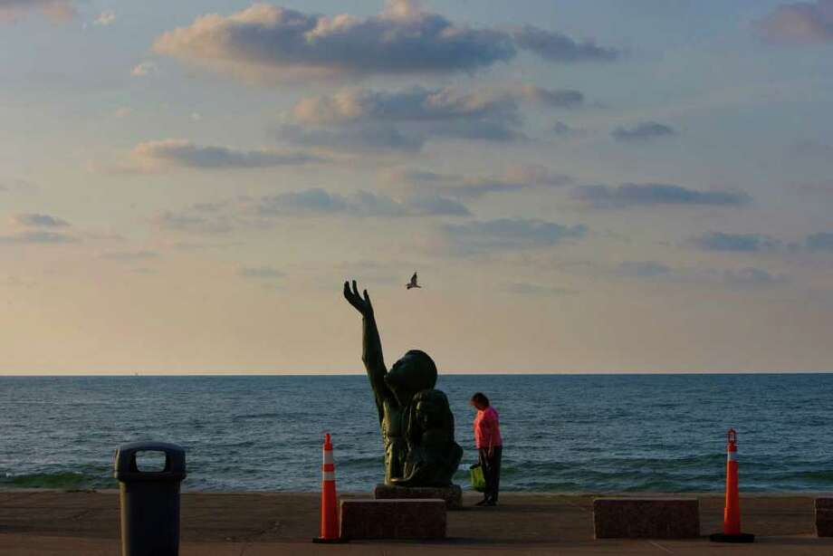 A statue on the Galveston seawall commemorates the hurricane of 1900, which killed more than 6,000 people. The hurricane inspired talk of a larger, more effective seawall in 1902. Johnny Hanson/Houston Chronicle / Houston Chronicle