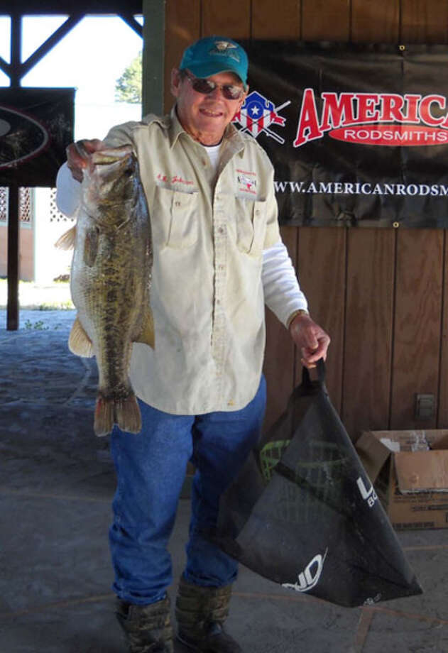 A.R. Johnson & Herb Newhouse (not pictured) win Big Bass honors with this nice 8.63 pounder and nab first place with a total weight of 20.63 lbs. that earned them $10,000 for their day on the water.