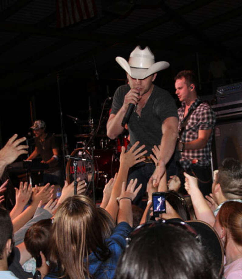 Justin Moore performs at Jasper Lions Rodeo Thursday night.