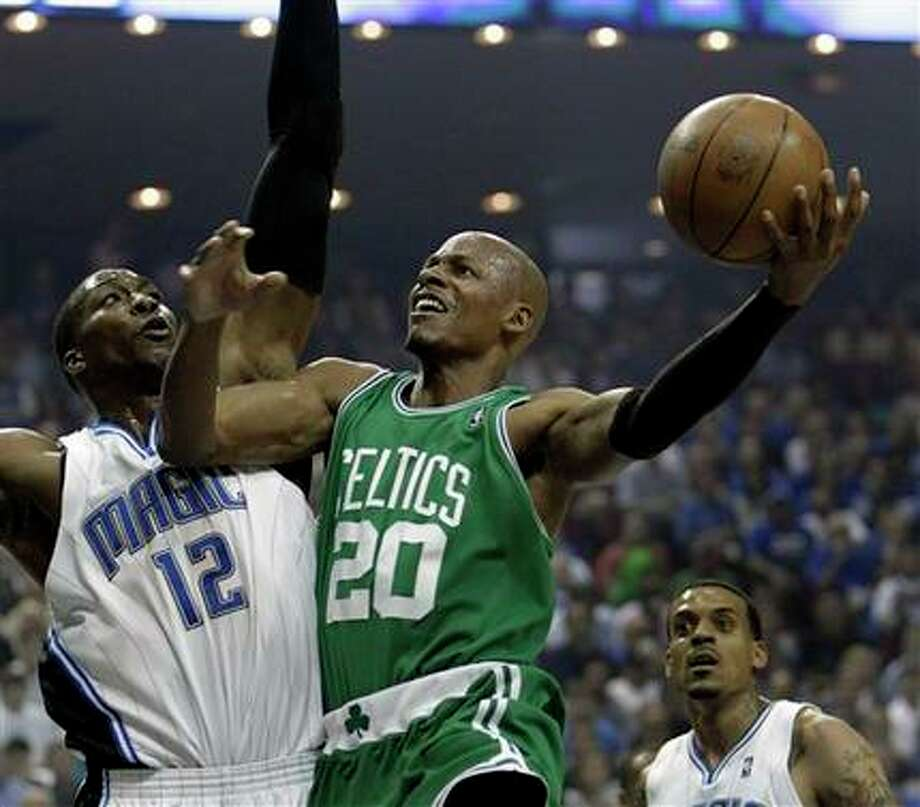 Boston Celtics guard Ray Allen (20) shoots over Orlando Magic center Dwight Howard (12) during the first half in Game 1 of the NBA Eastern Conference basketball finals in Orlando, Fla., Sunday, May 16, 2010. (AP Photo/John Raoux)