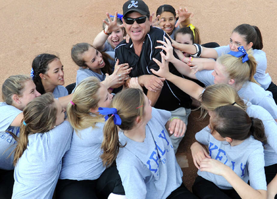 Kelly softball coach Dale Freeman poses with his team at Kelly High School in Beaumont. Tammy McKinley/The Enterprise / Beaumont