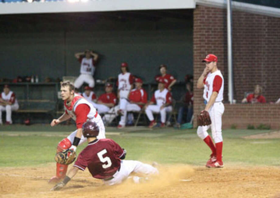 Jasper's Tyler Ernest scores the Bulldogs' one run during a 2-1 loss to Carthage Tuesday, April 6.
