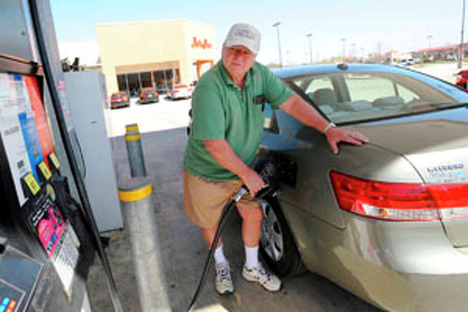 Beaumont resident Randy Moore watches the pump as he fills up his vehicle at the HEB station on Dowlen Rd. Moore said he thinks gas prices are on the verge of an increase. Valentino Mauricio/The Enterprise / Beaumont