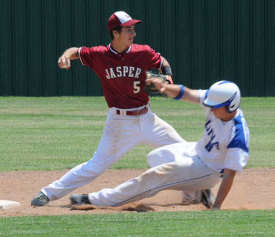 Jasper's Tyler Ernest turns a double play during Saturday's practice game with Buna.