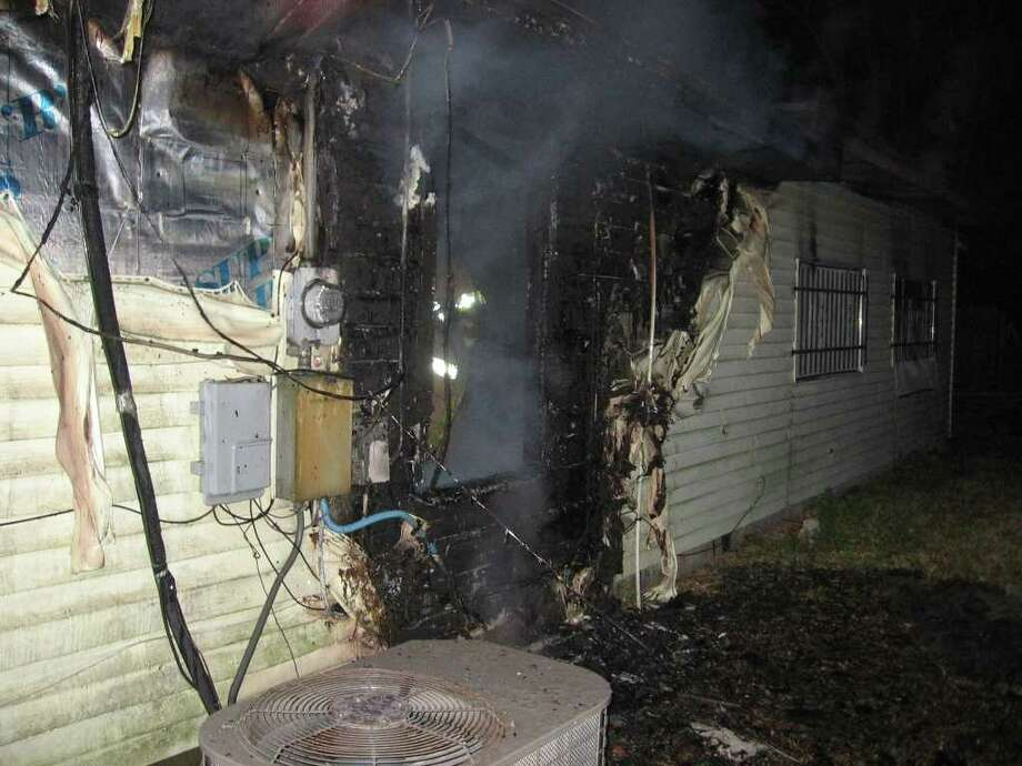 A fire burned the rear of a home early Thursday in Orange. Photo provided by the Orange Fire Department.