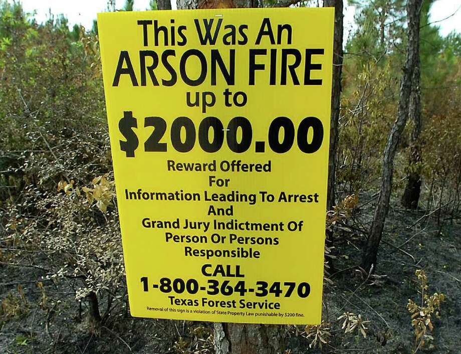 After Law Enforcement Investigators for the Texas Forest Service, have done their investigation of suspicious fires, they post these signs in the hopes that someone might come forward with some information they can follow up on.  There are several of these posted on Gist Road outside Buna.    Dave Ryan/The Enterprise / Beaumont
