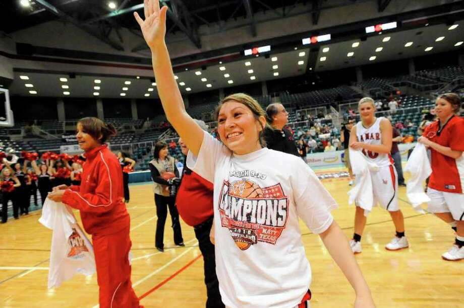 Lamar point guard Jenna Plumley waves to Cardinals fans after the Lady Cards won the Southland Conference Tournament Championship at the Merrell Center in Katy. Plumley will be a key player in the team's matchup against West Virginia on Sunday. Valentino Mauricio/The Enterprise / Beaumont