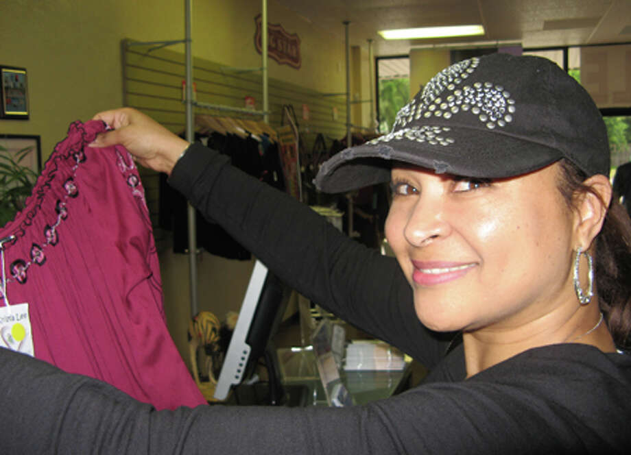 Altoria Prince displays her new purchase from Trendy's Unique Boutique. She's careful about what she buys these days and hunts for bargains. Dan Wallach/The Enterprise / Beaumont