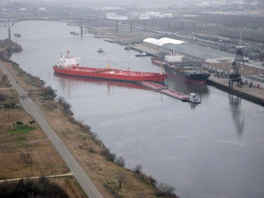 A pair of barges which were being pushed  by the towing vessel Dixie Vengeance sit lodged against the Eagle Otome, an 807-foot tanker, Saturday in the Sabine Neches Waterway next to the docks of the Port of Port Arthur. At about 9:30 a.m. Saturday, the Eagle Otome, carrying 570,000 barrels of crude oil, collided with the outbound barge, tearing open one of the Eagle Otome's cargo tanks. According to the Coast Guard up to 450,000 gallons of oil spilled into the waterway.  U.S. Coast Guard Photo