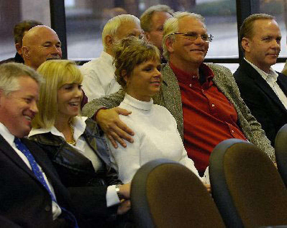 Fired Beaumont firefighter James Mathews, with his arm around his wife, Theresa, listens as friends, relatives and colleagues spoke to the Beaumont City Council in December 2009. Dave Ryan/The Enterprise