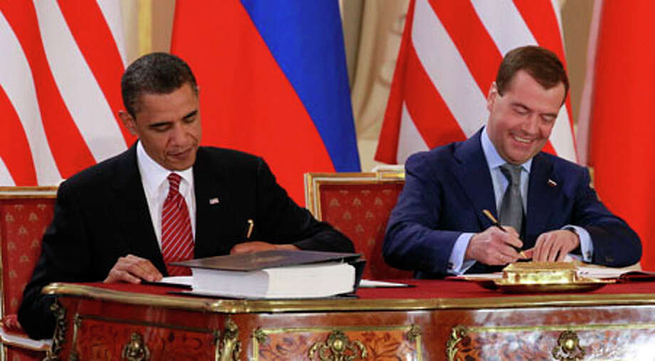 President Barack Obama signs the New START treaty with Russian president Dmitry Medvedev at the Prague Castle in Praguetoday. (AP Photo/Alex Brandon) / AP