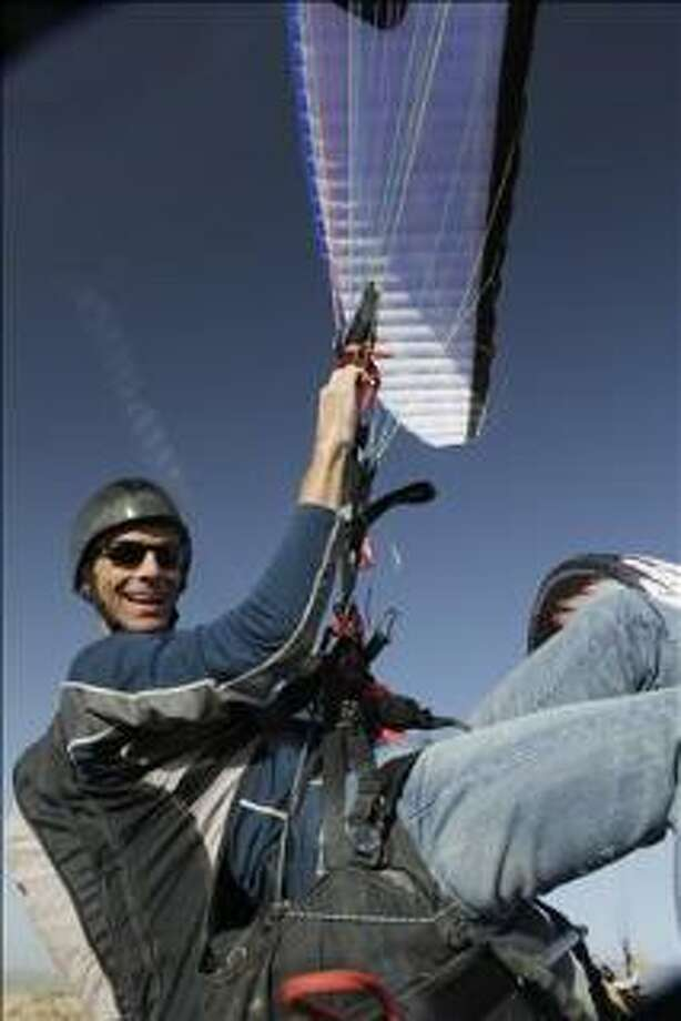 Bill Heaner, 49, is an extreme sports athlete who will attempt a world record jump this weekend. He is pictured here in his paraglider. Photo by Natalie Cass ? Cass Studios 2009