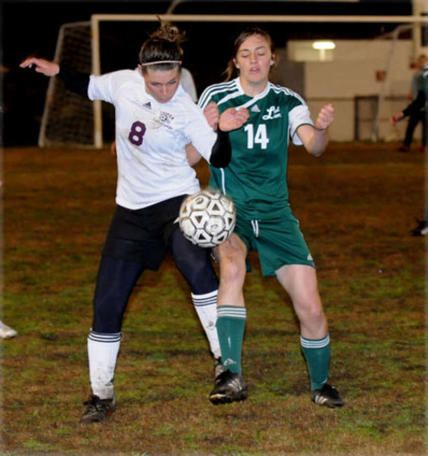 Tabitha Wagnon battles a Livingston player for a loose ball during last week?s home soccer action.