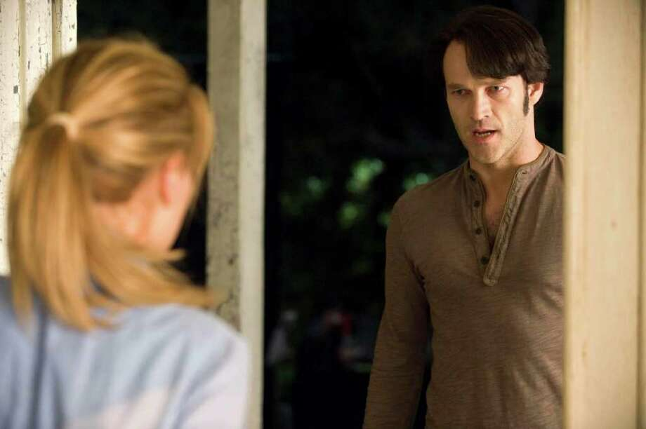 """In this image released by HBO, Anna Paquin stars as Sookie Stackhouse, left, and Stephen Moyer stars as vampire Bill Compton, in a scene from HBO's """"True Blood.""""  Photo by The Associated Press / HBO"""