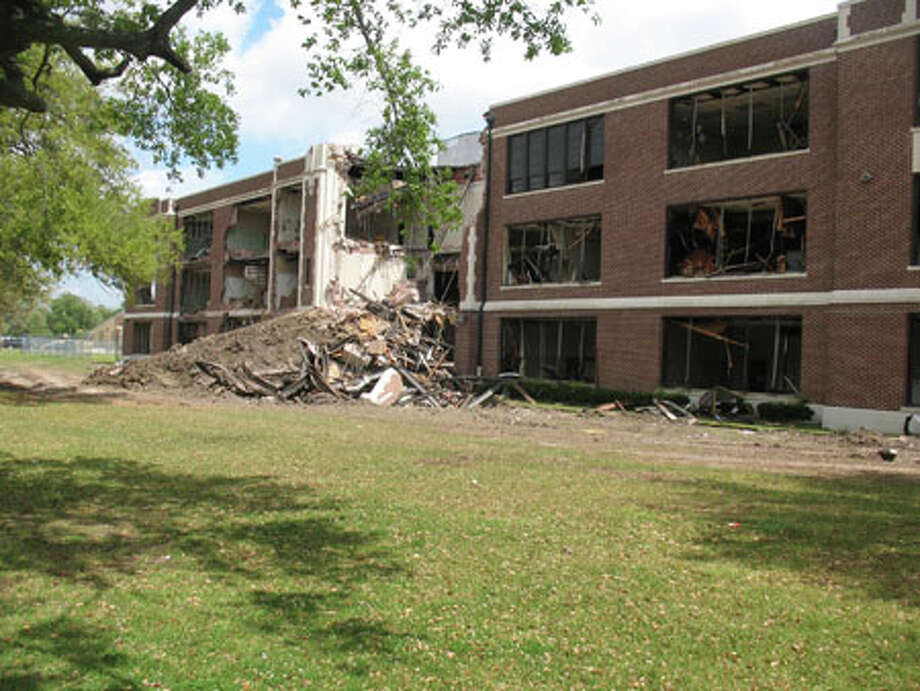 Demolition continued at South Park Middle School on Tuesday. Amy Moore/The Enterprise