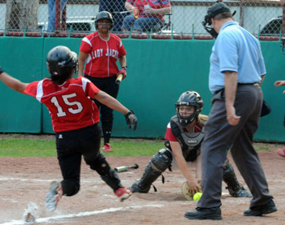 Jasper?s Kyanna Slaydon attempts the out at home but the ball is not quite in her glove as the runner hits the plate.