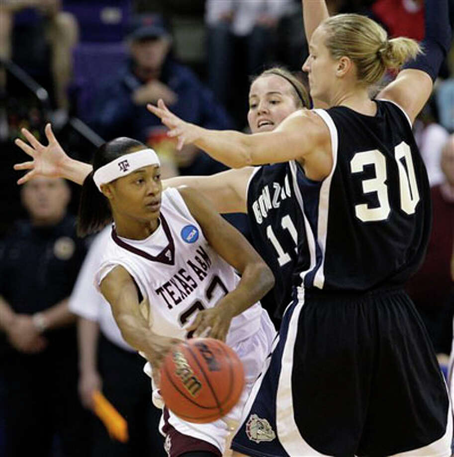 Gonzaga's Janelle Bekkering (11) and Heather Bowman (30) double-team Texas A&M's Tanisha Smith, left,during Monday's first half of an NCAA second-round college basketball tournament game in Seattle. Elaine Thompson/The Associated Press / AP
