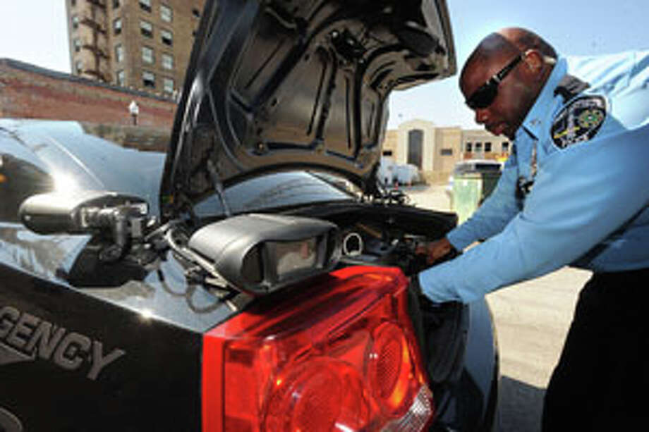 Port Arthur Police use license plate scanners mounted on patrol cars to detect car owners who have outstanding Class C warrants. Guiseppe Barranco/The Enterprise / Beaumont