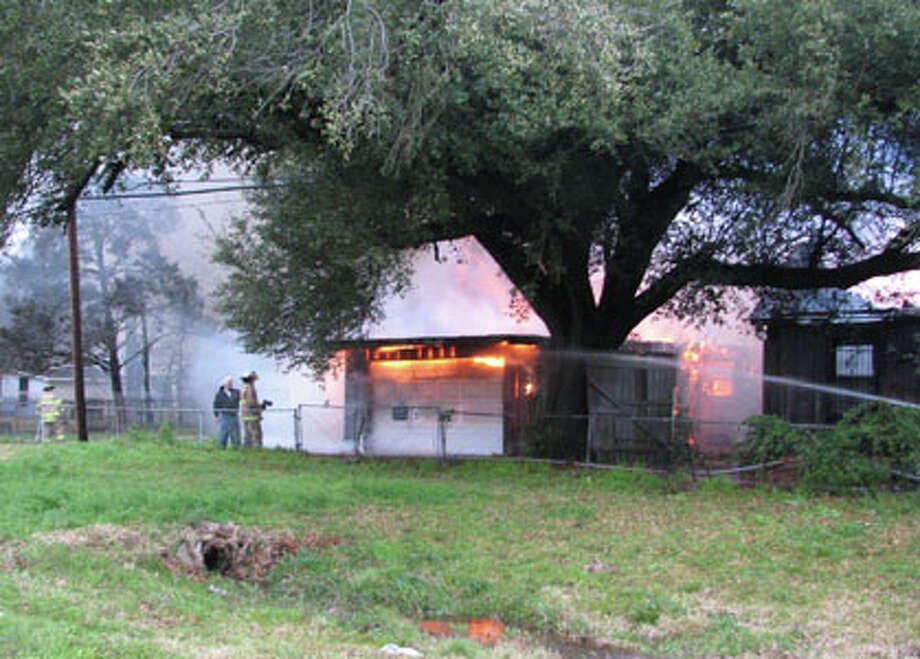 Nederland and Port Neches fire departments responded Monday afternoon to this house fire in the 3200 block of Fourth Street near Twin City Highway.  Ken Fountain/The Enterprise