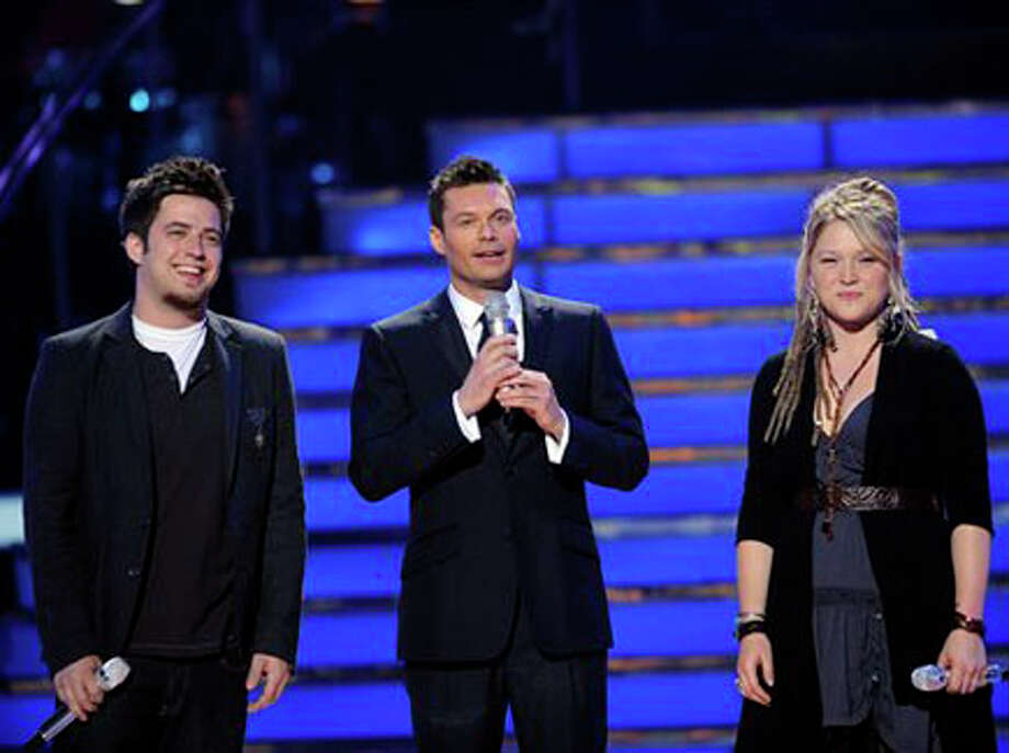 Contestant Lee DeWyze, host Ryan Seacrest and contestant Crystal Bowersox appear on stage at the American Idol Season 9 Top 2 Performance Show at the Nokia Theatre. AP Photo/Michael Becker/FOX/PictureGroup / 2010 Fox