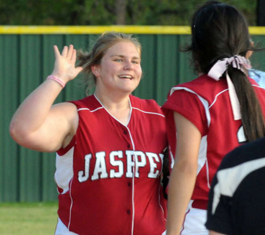 Jasper?s Lacy Dry being congratulated by her teammates after making one of her three great catches in center field.