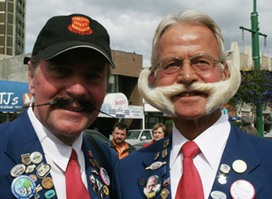Lutz Giasa, left, and Karl-Heinz Hiller, both of Berlin, Germany, participate in the 2009 World Beard and Moustache Championships. Moustaches might be having a trendy moment with fashion insiders, models and Facebook fan pages. AP Photo / AP2009