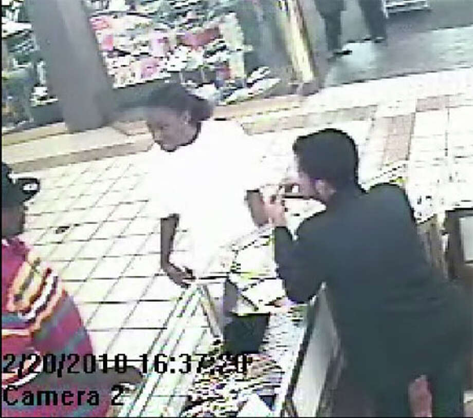 This video still from a Parkdale Mall surveillance camera shows the two people Crime Stoppers suspect have been using a stolen debit card. Photo provided by Beaumont Crime Stoppers.