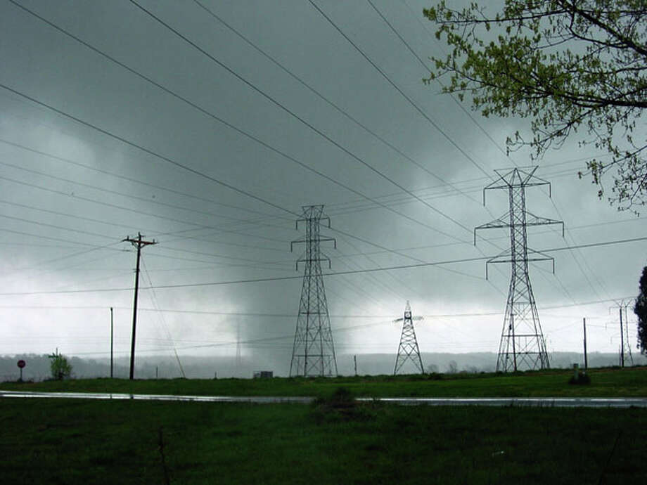 A Sunday, March 29, 2010 photo provided by Eric Sifford shows a funnel cloud seen at about 7 pm near I-85 and Highway 50 in Linwood, N.C.  Residents along a 150-mile swath of North Carolina were securing homes ripped open to the elements and a handful of people were nursing injuries Monday after a series of suspected tornadoes churned through the region. (AP Photo/Eric Sifford) / AP