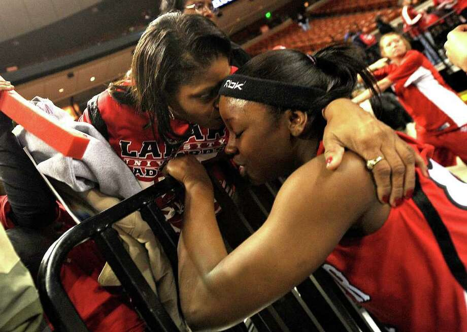 Lamar's Ang Green is consoled by her mother Alma Green after the Lady Cards' loss against West Virginia in the first round of the NCAA tournament. Guiseppe Barranco/The Enterprise / Beaumont
