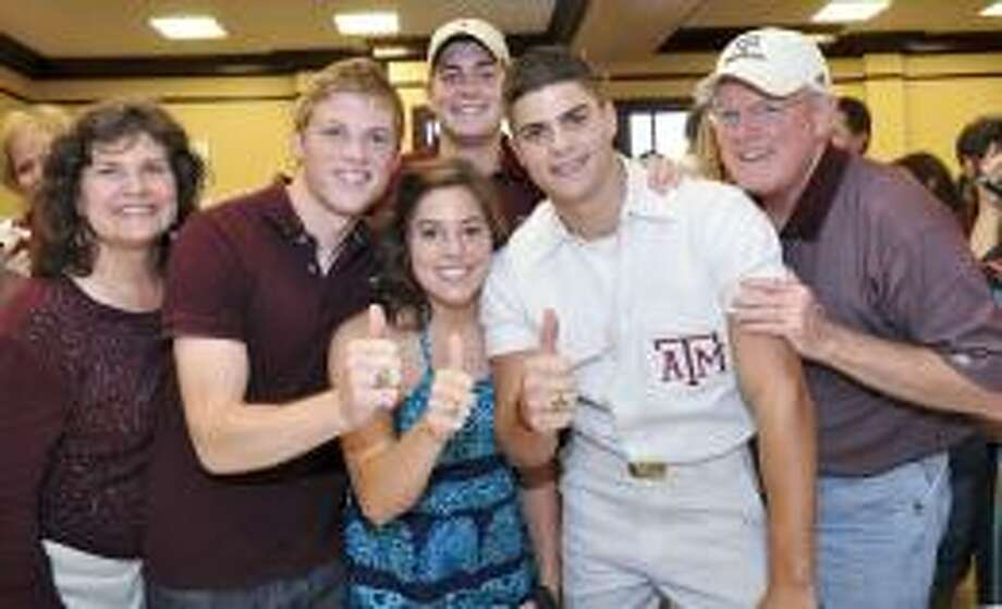 Debbie and Tab Thompson flank their quadruplets ? Daniel, Patrick, Kayla and Reagan ? who are to graduate Friday from Texas A&M University, the first set of Aggie quadruplets. Submitted photo/Houston Chronicle