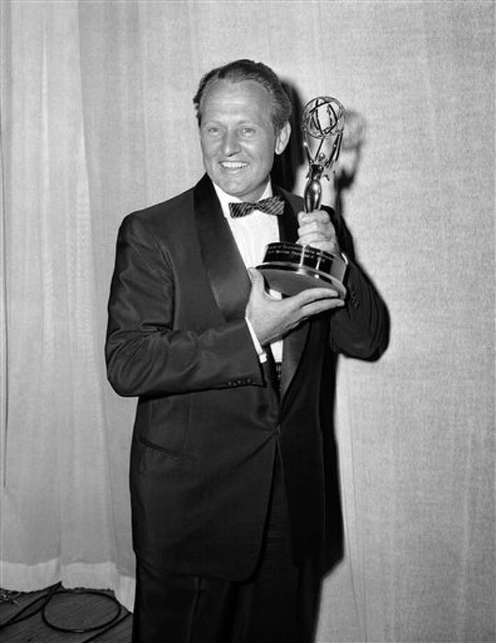 "This March 7, 1955 file photo shows Art Linkletter posing with the Emmy awarded to him by the Television Academy for the best daytime program, in Los Angeles. Linkletter, who hosted the popular TV shows ""People Are Funny"" and ""House Party"" in the 1950s and 1960s, died Wednesday, May 26, 2010 at his home in the Bel-Air section of Los Angeles.  He was 97. (AP Photo, File)"