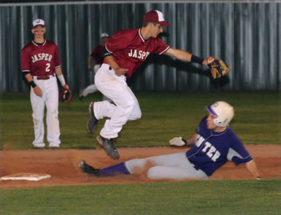 Jasper shortstop Tyler Ernest takes a late throw during Thursday's victory over Center.