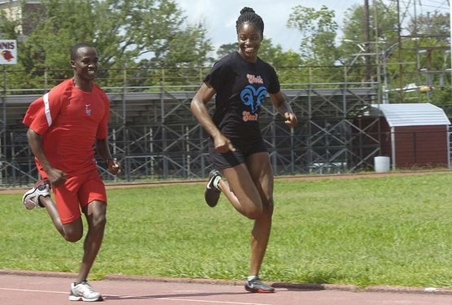 Ashley Idunoba, right, and Samuel Kosgei, left, of the Lamar Track team, get in some running Monday morning.  Five members of the team will compete in the first round of the NCAA Division 1 Track and Field Championships next week in Austin. Idunoba will run in the women's 200 meters and Kosgei will compete in the men's 10,000 meters.  Dave Ryan/The Enterprise / Beaumont