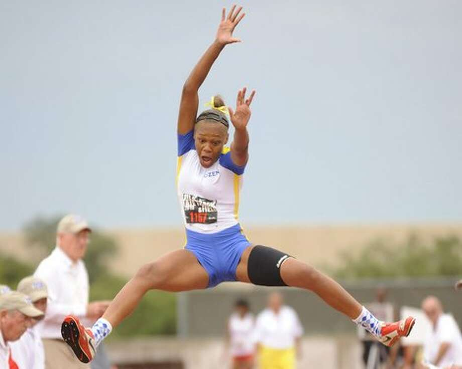 Ozen's A'Lexus Brannon leaps to victory with a 20' 3'' distance in the long jump event during the UIL State Track and Field Championships at Mike A. Myers Stadium in Austin, Texas on Friday. / Beaumont