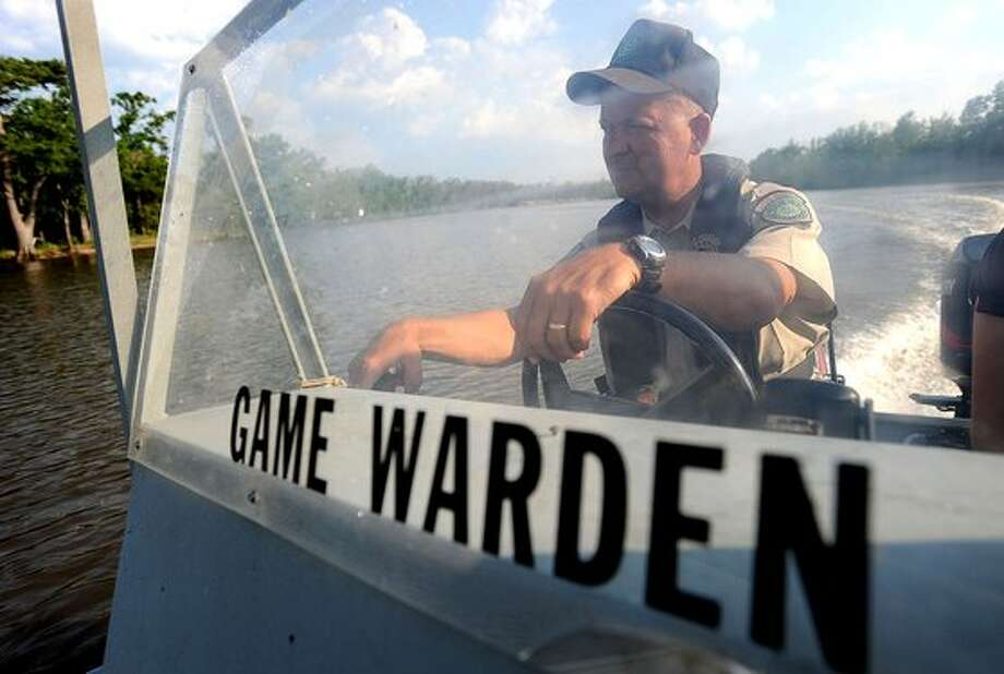 With the Memorial Day holiday close at hand, boaters are expected to run on area waters and to practice safe boating. Mike Boone game warden for the TPWD patrols the Neches waters Thursday looking for boaters violating safety laws. Guiseppe Barranco/The Enterprise / Beaumont