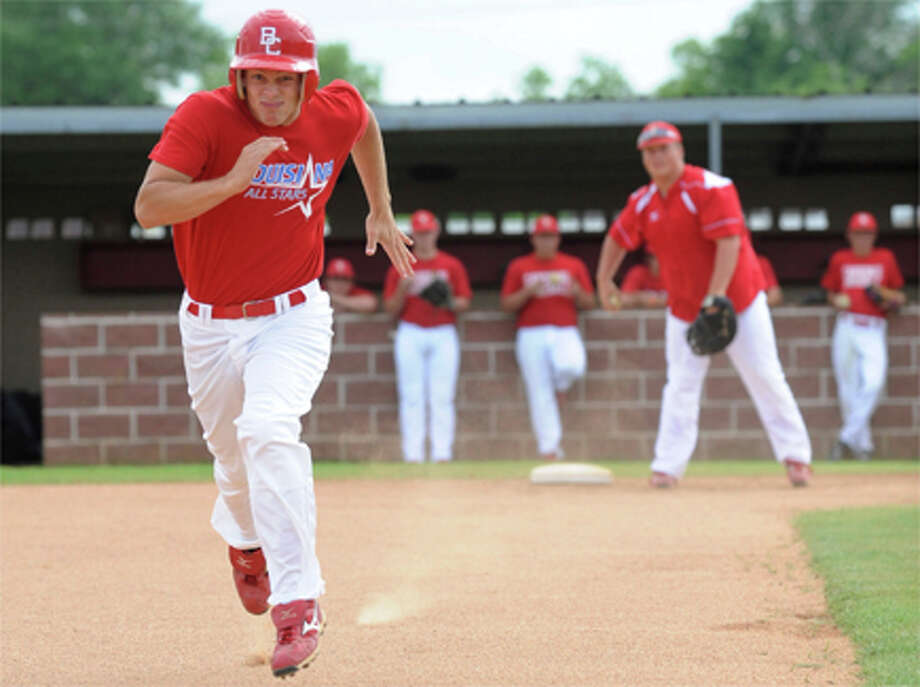 Bridge City player Matt Hicks works on running the bases during a team practice. Valentino Mauricio/The Enterprise