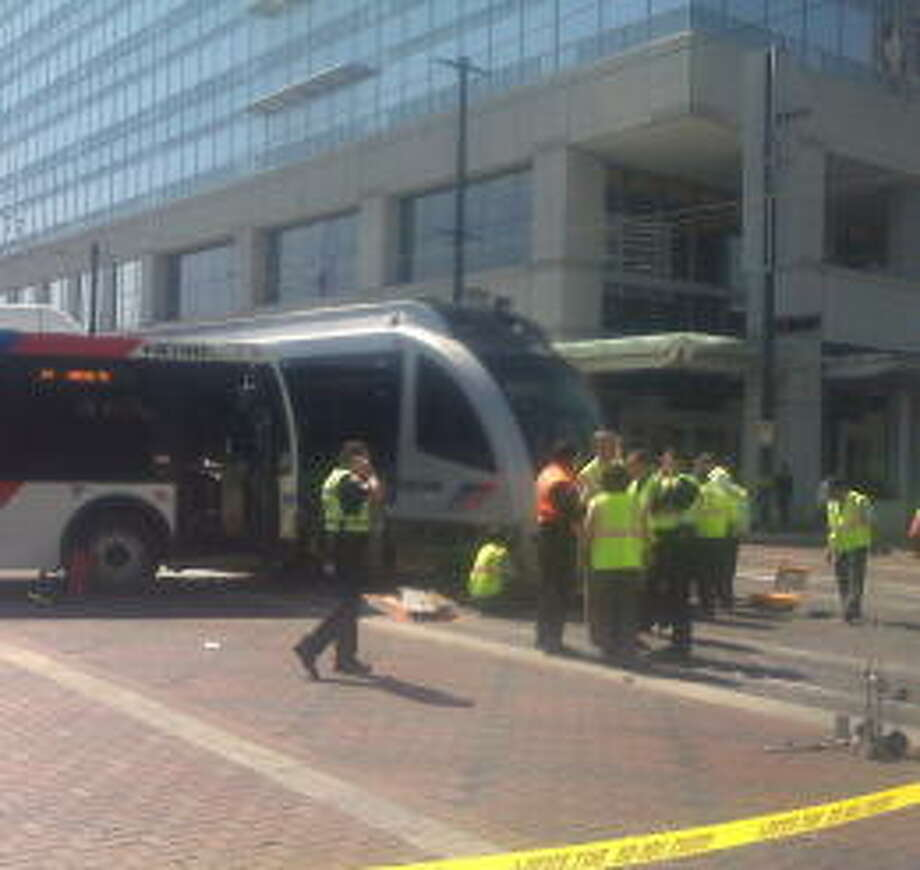 Metro officials and police investigate the collision in downtown Houston.  Julio Cortez/Houston Chronicle