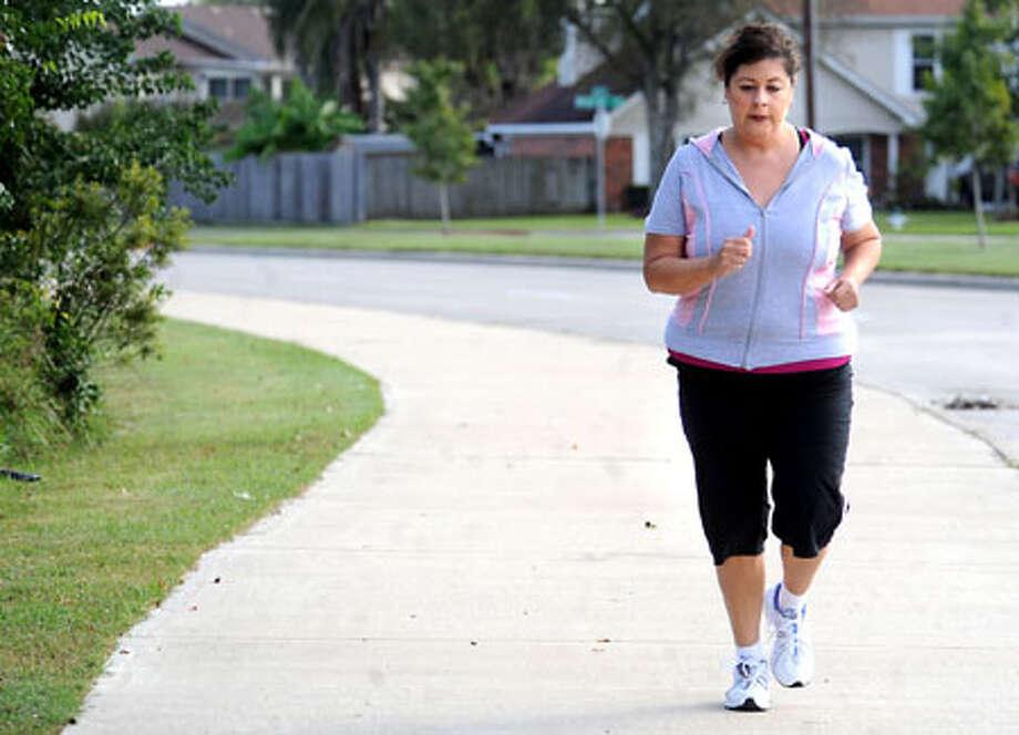 Andrea Munoz jogs down Delaware Street in Beaumont. Munoz will run the Gusher Marathon tomorrow. Tammy McKinley/The Enterprise / Beaumont