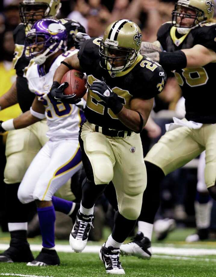 New Orleans Saints running back Pierre Thomas (23) breaks away to score on 38-yard touchdown run in the first quarter of the NFC Championship game against the Minnesota Vikings in New Orleans on Jan. 24. The 2010 NFL opener will see Saints-Vikings rematch on Thursday, Sept. 9. (The Associated Press//Bill Haber) / FR170136 AP