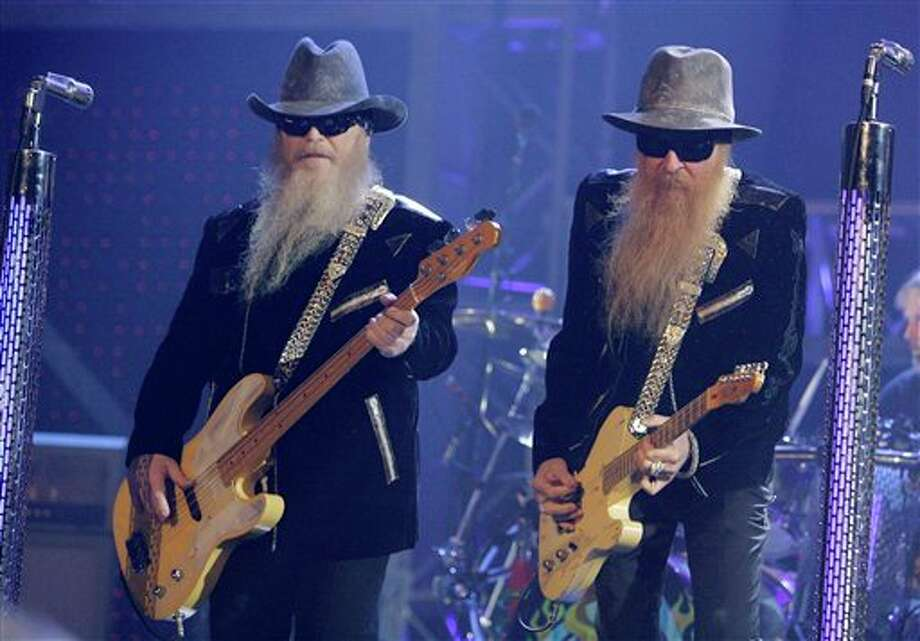 **FILE**  Dusty Hill and Billy Gibbons, right, of ZZ Top perform during the VH1 Rock Honors concert at the Mandalay Bay hotel-casino in Las Vegas on  May 12, 2007. The duo has canceled its European tour so Hill can undergo treatment for a benign growth in his inner ear that's affecting his hearing. Its European tour was to start June 15 in Leipzig, Germany, and run into early July.(AP Photo/Jae C. Hong)