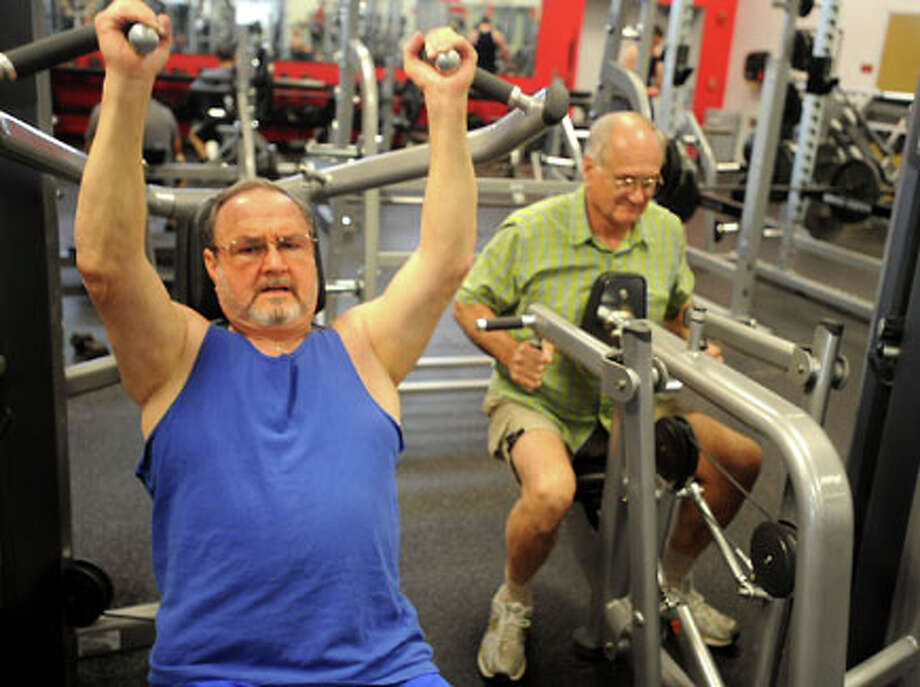 Charles Wolfe and Jim Silvernail work out in the gym at the YMCA in Port Arthur. Tammy McKinley/The Enterprise / Beaumont