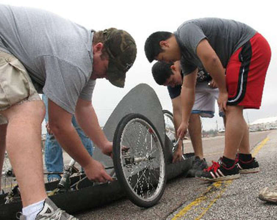 Members of the Lamar University Engineering Department Shell Eco-Marathon team work on minor finishes on their hand made, carbon fiber, hydrogen fuel cell car. Amy Moore/The Enterprise