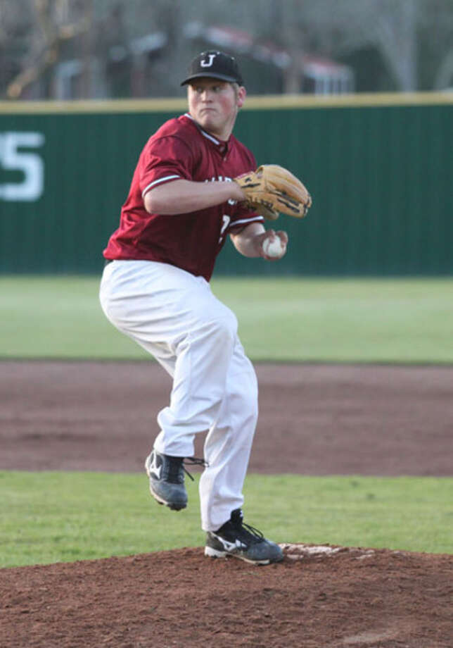Jasper's Derek Sowell delivers a pitch home during the Bulldogs' victory over Diboll Tuesday, March 30.