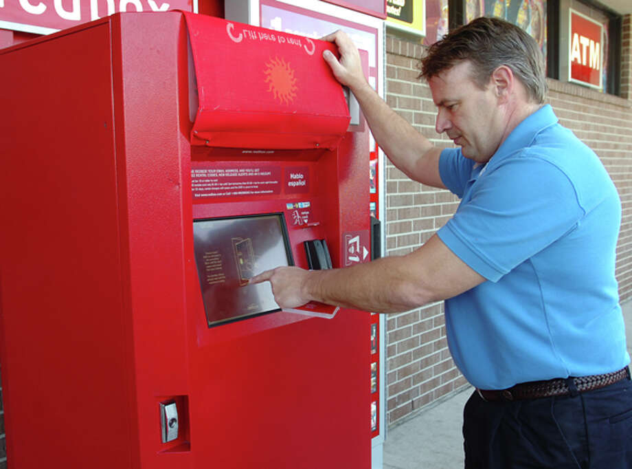 Kent Heiman exchanges DVDs at a rental machine at a drug store in Beaumont. Pete Churton/The Enterprise / Beaumont