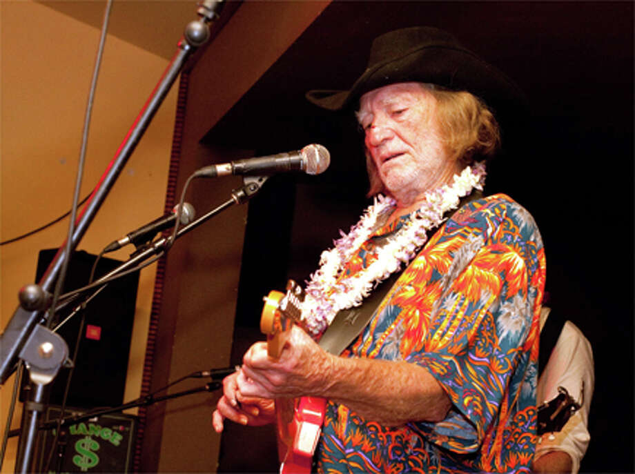 Legendary crooner Willie Nelson performs with his son Micah Nelson's band, The Reflectacles, on Saturday at Charley's in Maui, Hawaii. A spokeswoman said Nelson, who's been hanging loose in Hawaii, got his hair cut in the past couple of weeks. AP Photo/Jessica Pearl