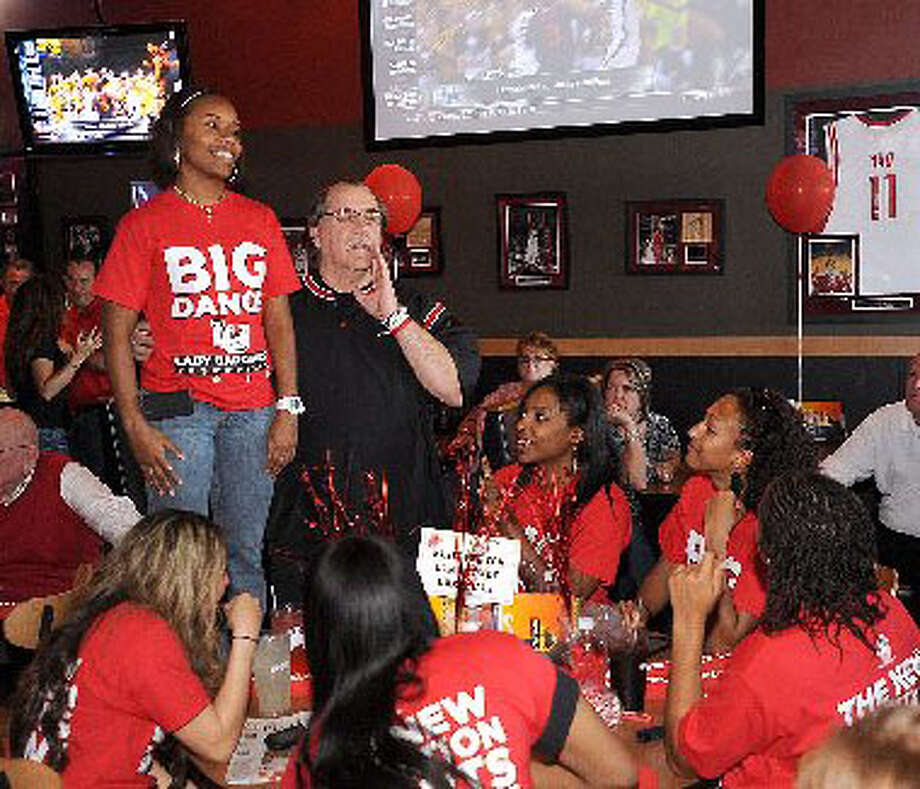 Lamar University's Larry Tidwell introduces Ashley Crawford to a large audience gathered to watch game line up for the woman's NCAA tournament. Guiseppe Barranco/The Enterprise