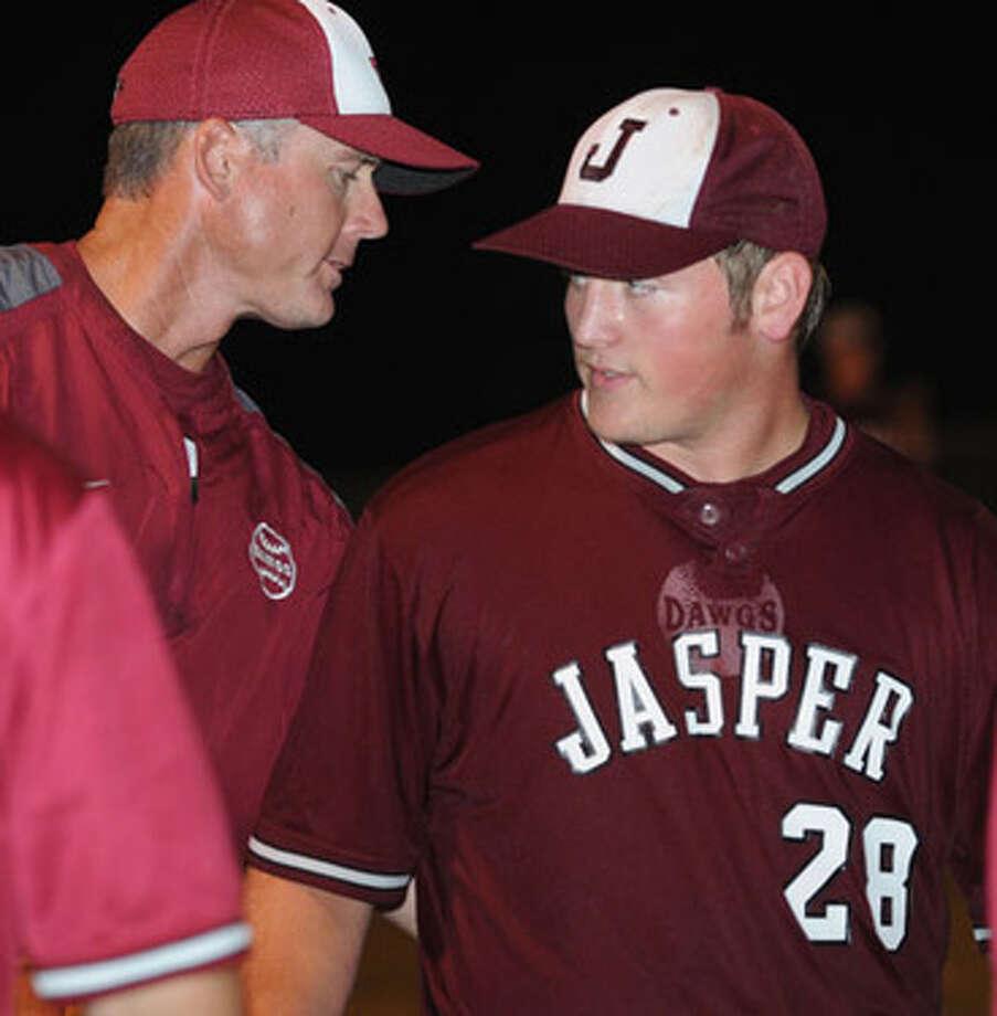 Jasper's Derek Sowell is congratulated by Jasper Head Baseball Coach Shawn Mixon following the Dawgs' victory over Lufkin Hudson Friday, May 21.