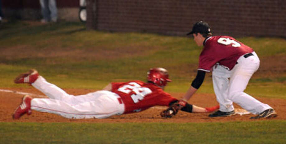 Jasper?s Jacob Clark gets the tag on a pick-off  throw from pitcher Derek Sowell.
