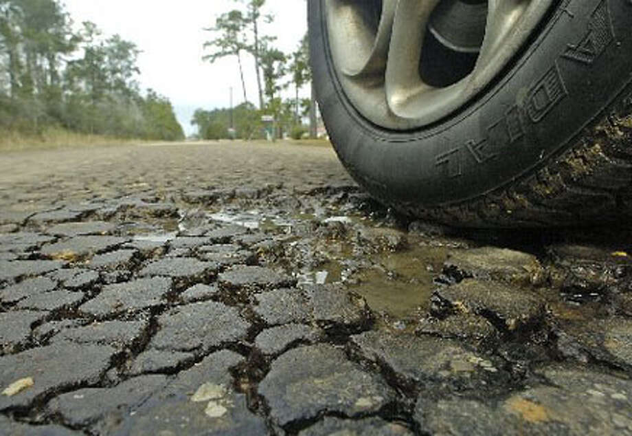 Roads, especially in rural areas, are suffering because of extra rainy weather. The start of a potholes, which can be caused by rain soaking through the road surface, are numerous on Shepard Road, also known as County Road 737, outside Buna. Dave Ryan/The Enterprise