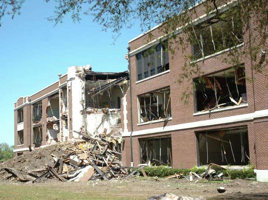 The demolition of the former South Park Middle School continued Thursday. Memorabilia from the school will be made available to the public on Saturday from 8 a.m. to noon. Pete Churton/The Enterprise / Beaumont